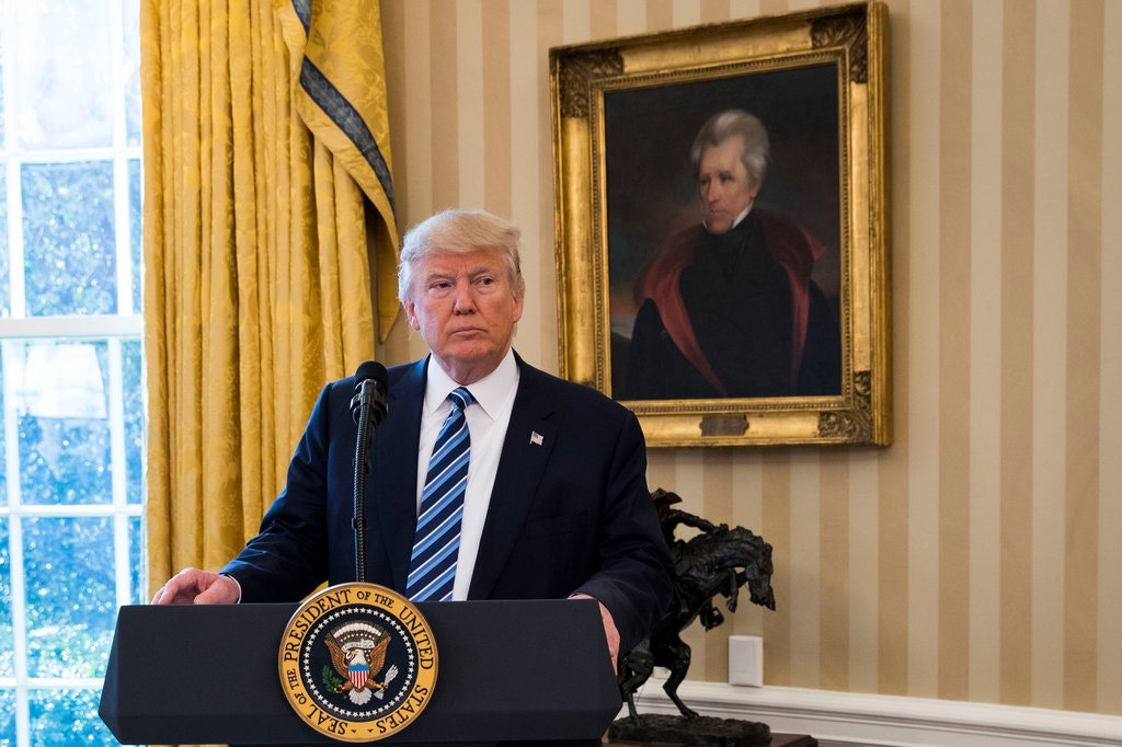 A portrait of Andrew Jackson behind President Trump in the Oval Office. Credit...Doug Mills/The New York Times