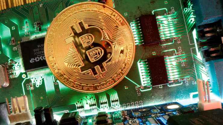 Cryptocurrencies are close to reaching a big milestone versus gold by one Wall Street firm's count